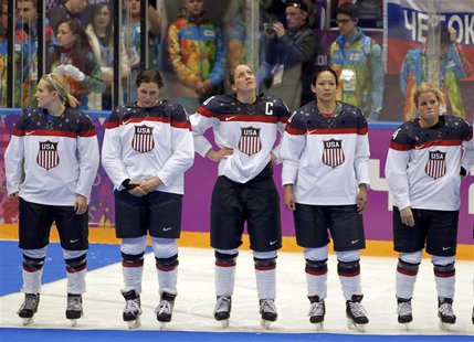 Team USA's Monique Lamoureux, Megan Bozek, Meghan Duggan, Julie Chu and Brianna Decker (L-R) stand dejected after losing their women's gold