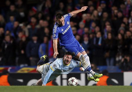 Chelsea's John Terry (R) challenges Steaua Bucharest's Pantelis Kapetanos during their Champions League soccer match at Stamford Bridge in L