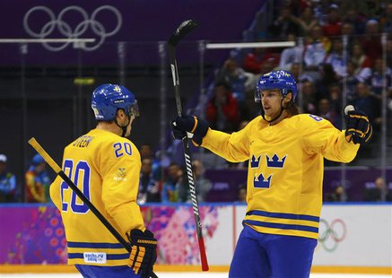 Sweden's Erik Karlsson (R) celebrates his goal against Finland with teammate Alexander Steen during the second period of the men's ice hocke