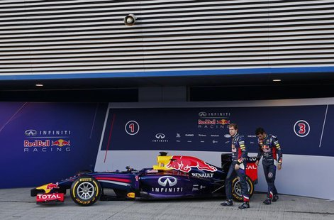 Red Bull Formula One drivers Sebastian Vettel (L) of Germany and Daniel Ricciardo of Australia walks after unveiling the new RB10 during the