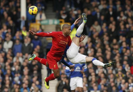 Liverpool's Glen Johnson (L) challenges Everton's Ross Barkley during their English Premier League soccer match at Goodison Park in Liverpoo