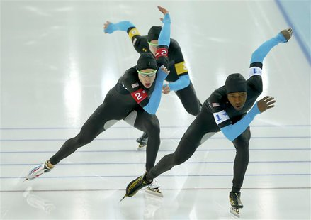REFILE - CORRECTING BYLINE Shani Davis of the U.S. leads Brian Hansen and Jonathan Kuck of the U.S. in the men's speed skating team pursuit