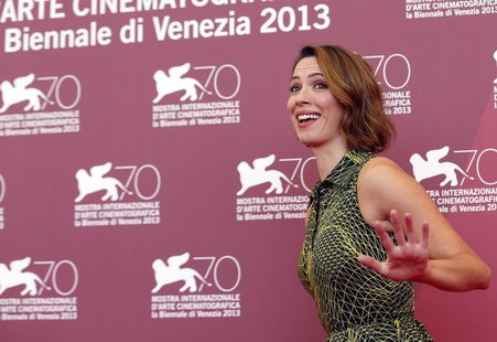 "Actress Rebecca Hall poses during a photocall for the movie ""Une Promesse"", directed by Patrice Leconte, during the 70th Venice Film Festiva"