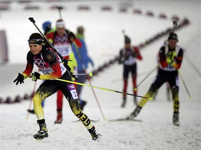 Germany's Evi Sachenbacher-Stehle (front) competes during the women's biathlon 10km pursuit event at the 2014 Sochi Winter Olympics, in this