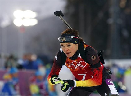 Germany's Evi Sachenbacher-Stehle leaves the shooting range during the mixed biathlon relay at the Sochi 2014 Winter Olympics, in this pictu