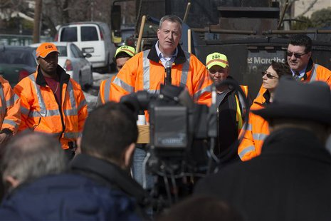 New York Mayor Bill de Blasio speaks to the press during a news conference in the Maspeth section of Queens, New York February 20, 2014. REU