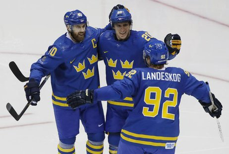 Sweden's Henrik Zetterberg (40) celebrates his goal with teammates Alexander Steen (20) and Gabriel Landeskog (92) during the second period