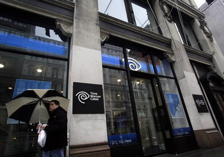 A man walks past the Time Warner Cable headquarters in New York February 13, 2014. REUTERS/Joshua Lott