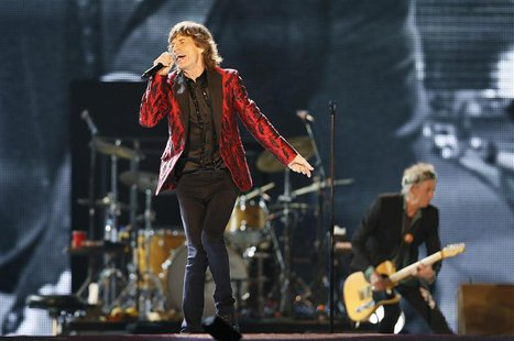 Mick Jagger of the Rolling Stones performs during a concert in Abu Dhabi February 21, 2014. REUTERS/ Stringer