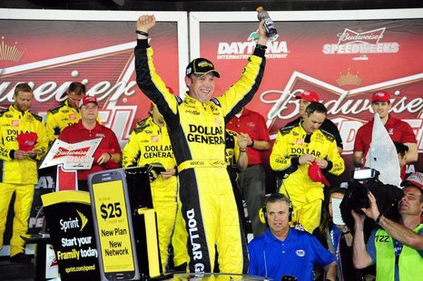 Feb 20, 2014; Daytona Beach, FL, USA; NASCAR Sprint Cup driver Matt Kenseth (20) celebrates winning race one of the Budweiser Duel at Dayton