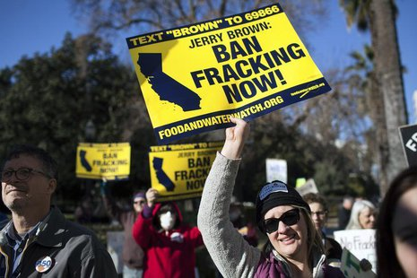 Kimberly Ramsey (R) protests fracking outside the State Capitol after Governor Jerry Brown delivered his State of the State address at the C