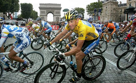 Discovery Channel team rider Armstrong passes the Arc de Triomphe in Paris after winning his seventh Tour de France in this July 24, 2005, f