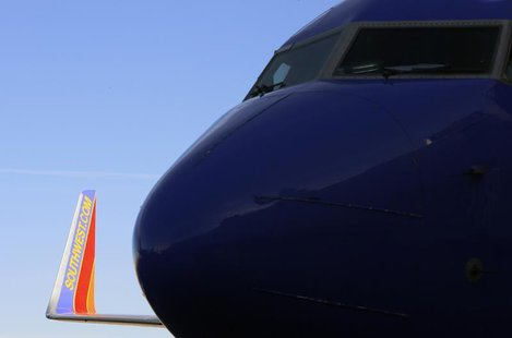 A Southwest Airlines jet waits on the tarmac at Denver International Airport in Denver January 22, 2014. REUTERS/Rick Wilking