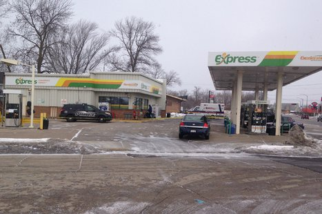 Neenah police investigate an armed robbery at a gas station on S. Commercial St., Feb. 21, 2014. (Photo from FOX 11).