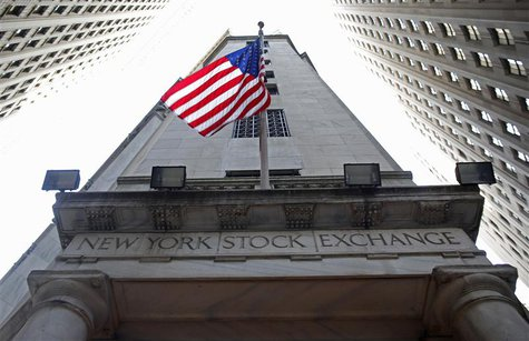 A flag flutters in the wind outside the New York Stock Exchange November 5, 2012. REUTERS/Chip East
