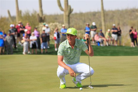 Feb 21, 2014; Marana, AZ, USA; Rickie Fowler speaks with Sergio Garcia (not shown) on the green of the seventh hole. The players agreed to g