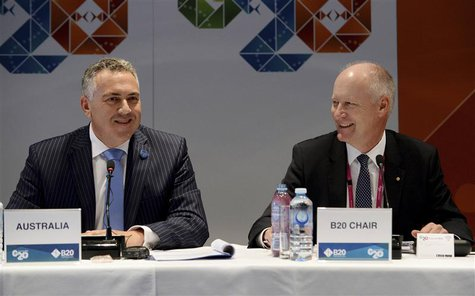 Australian Treasurer Joe Hockey (L) and CEO of Wesfarmers Richard Goyder attend the Joint G20 and B20 Infrastructure Roundtable as part of t