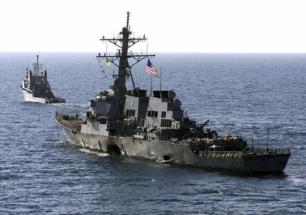 The U.S. Navy destroyer USS Cole (DDG 67) is towed away from the port city of Aden, Yemen, into open sea by the Military Sealift Command oce