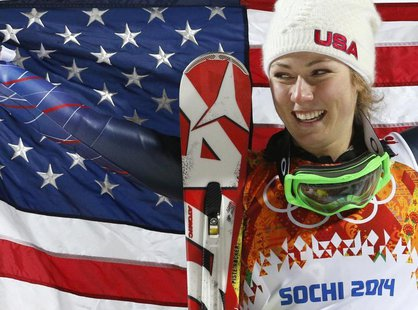 First-placed Mikaela Shiffrin of the U.S. poses with a U.S. flag during the flower ceremony for the women's alpine skiing slalom event at th