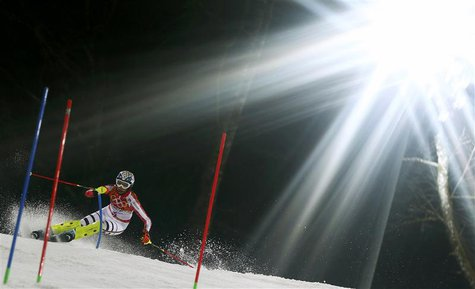 Germany's Maria Hoefl-Riesch clears a gate during the second run of the women's alpine skiing slalom event at the 2014 Sochi Winter Olympics
