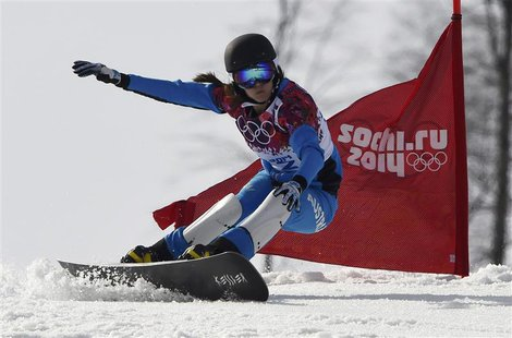 Austria's Julia Dujmovits competes during the women's parallel slalom snowboard finals at the 2014 Sochi Winter Olympic Games in Rosa Khutor