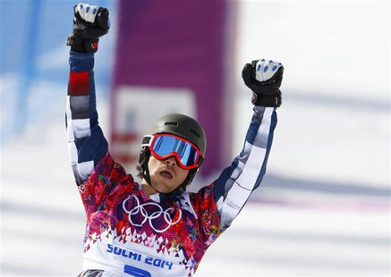 Russia's Vic Wild reacts after crossing the finish line during the men's parallel slalom snowboard finals at the 2014 Sochi Winter Olympic G