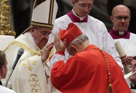 Pope Francis blesses newly elected cardinal Lorenzo Baldisseri of Italy during a consistory ceremony in Saint Peter's Basilica at the Vatica