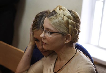 Ukrainian ex-prime minister Yulia Tymoshenko (R) and her daughter Yevhenia attend a session at the Pecherskiy district court in Kiev in this