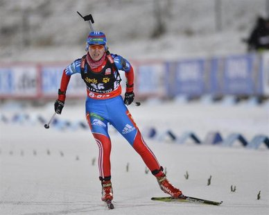 Ekaterina Glazyrina of Russia crosses the finish line during the women's 15 km individual event at the Biathlon World Cup in Ostersund Novem