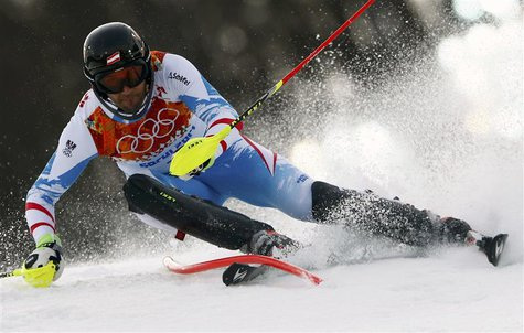 Austria's Mario Matt clears a gate during the first run of the men's alpine skiing slalom event at the 2014 Sochi Winter Olympics at the Ros