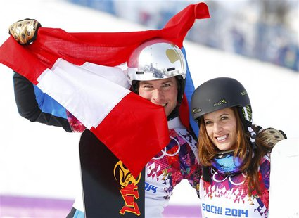 Austria's Julia Dujmovits (R), winner of the women's parallel slalom snowboard final, and her compatriot Benjamin Karl (L), who finished thi