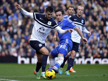 Chelsea's Frank Lampard (R) challenges Everton's Kevin Mirallas during their English Premier League soccer match at Stamford Bridge in Londo