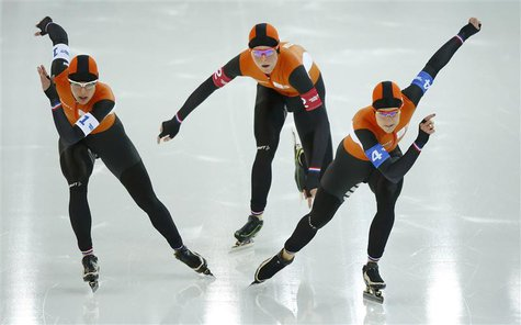 (L-R) Marrit Leenstra, Jorien Ter Mors and Irene Wust of the Netherlands compete in the women's speed skating team pursuit semi-finals durin