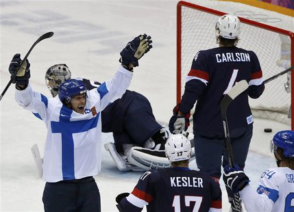 Finland's Teemu Selanne (L) celebrates his goal as Team USA's Ryan Kesler and John Carlson react during the third period of their men's ice