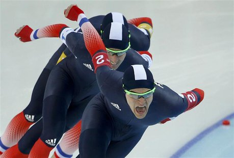Ewen Fernandez of France leads his team in the final to decide 7th and 8th place in the men's speed skating team pursuit race during the 201