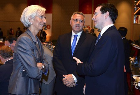 International Monetary Fund Managing Director Christine Lagarde (L) chats with Britain's Chancellor of the Exchequer George Osbourne (R) and
