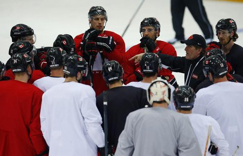 Canada's men's ice hockey team head coach Mike Babcock speaks to his team during a practice at the 2014 Sochi Winter Olympics, February 22,