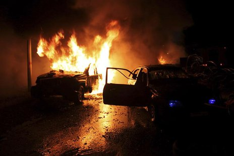 Cars burn at the site of an explosion in the Shi'ite town of Hermel February 22, 2014. REUTERS/Rami Bleibel