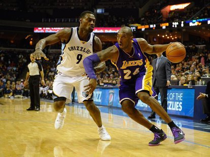 Dec 17, 2013; Memphis, TN, USA; Memphis Grizzlies shooting guard Tony Allen (9) guards Los Angeles Lakers shooting guard Kobe Bryant (24) du