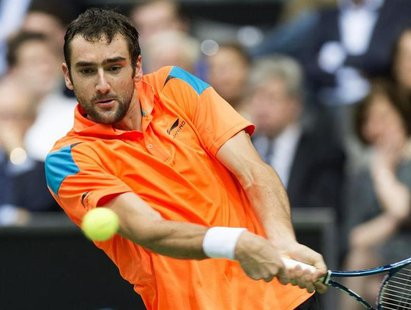 Marin Cilic of Croatia hits a backhand against Tomas Berdych of Czech Republic during their final match the ABN AMRO tennis tournament in Ro