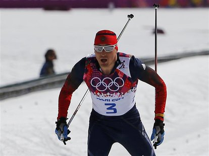 Russia's Alexander Legkov approaches the finish line to win the men's cross-country 50 km mass start free event at the Sochi 2014 Winter Oly