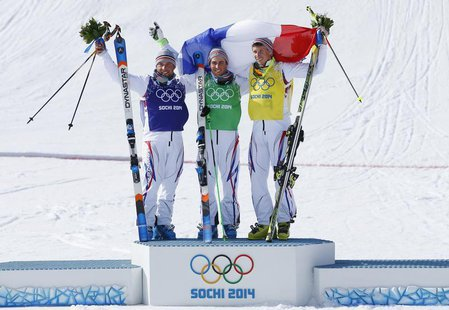 From L-R: Second-placed France's Arnaud Bovolenta poses with compatriots winner Jean Frederic Chapuis and third-placed Jonathan Midol on the