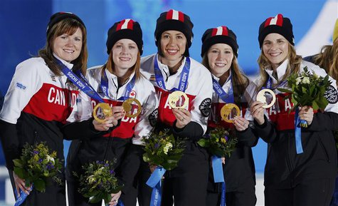 Gold medallists Canada's Jennifer Jones, Kaitlyn Lawes, Jill Officer, Dawn McEwen and Kirsten Wall (R-L) pose during the victory ceremony fo