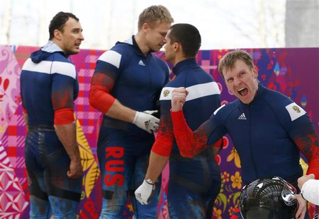 Russia's pilot Alexander Zubkov (R) reacts during the four-man bobsleigh event of the Sochi 2014 Winter Olympic Games at the Sanki Sliding C