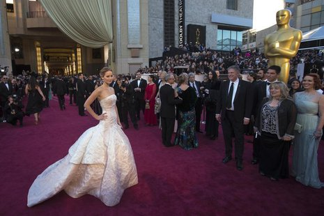 "Jennifer Lawrence, best actress nominee for her role in the film ""Silver Linings Playbook,"" arrives at the 85th Academy Awards in Hollywood,"