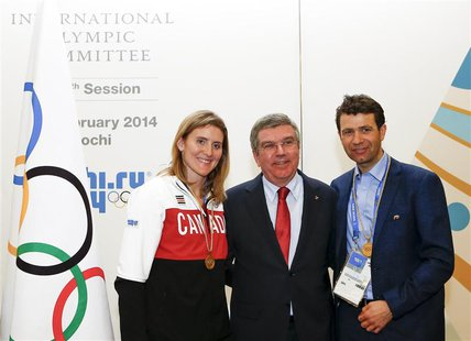 International Olympic Committee (IOC) President Thomas Bach (C) pose with newly elected members of the IOC, Canada's Hayley Wickenheiser (L)