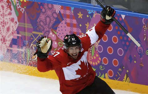 Canada's Sidney Crosby celebrates after scoring on Sweden during the second period of the men's ice hockey gold medal game at the 2014 Sochi