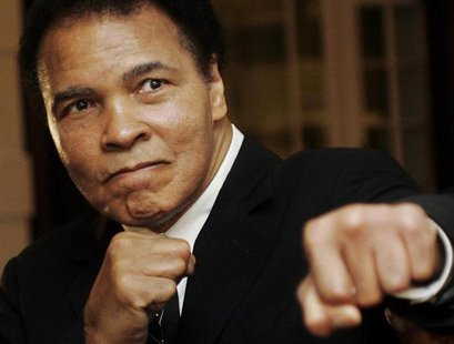 U.S. boxing great Muhammad Ali poses during the Crystal Award ceremony at the World Economic Forum (WEF) in Davos, Switzerland January 28, 2