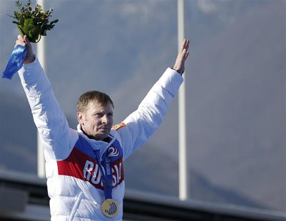 Russia's pilot Alexander Zubkov poses with a gold medal during a ceremony for the four-man bobsleigh event at the Sochi 2014 Winter Olympics