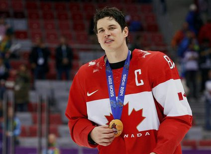 Canada's Sidney Crosby holds his gold medal at the victory ceremony for the men's ice hockey competition at the Sochi 2014 Winter Olympic Ga